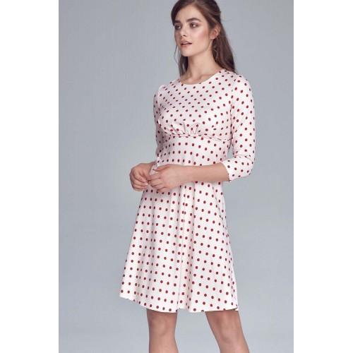 Smotanové bodkované šaty s prestrihnutím s130